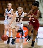Trinity's Emma Kate Smith (12) drives against Handley's Ari Kyles (2) in AHSAA regional basketball action in Montgomery, Ala., on Monday February 17, 2020.