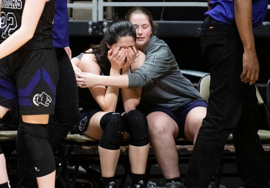 Prattville Christian's Tori DeMaio (5) is hugged after losing to T.R. Miller in AHSAA regional basketball action in Montgomery, Ala., on Monday February 17, 2020.