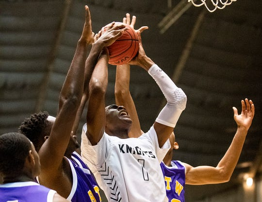 Catholic's Justin Bufford (1) grabs a rebound against B.T. Washington in AHSAA regional basketball action in Montgomery, Ala., on Monday February 17, 2020.