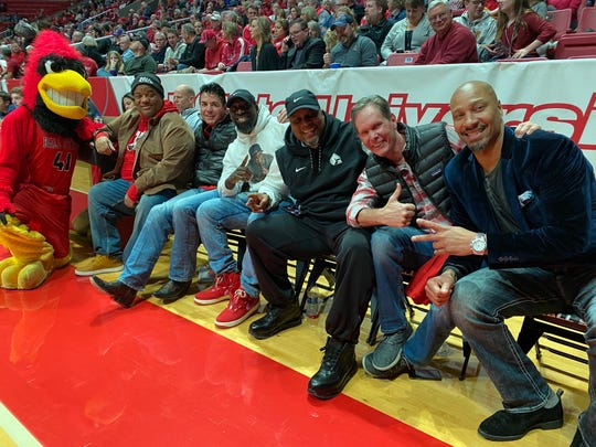 Jason Whitlock and John Schnatter (left to right) join other Ball State University alumni  at a men's basketball game on Saturday, Feb. 15, 2020.