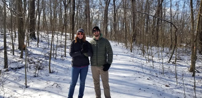 A happy couple (including the author) enjoy Munsee Woods, a Red-tail Land Conservancy property.