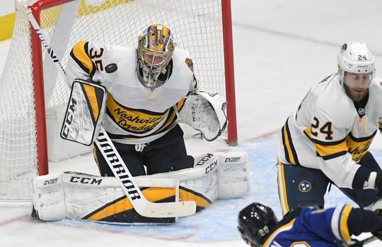 Predators goaltender Pekka Rinne (35) blocks a shot during a game with St. Louis at Bridgestone Arena in Nashville on Sunday, Feb. 16, 2020.