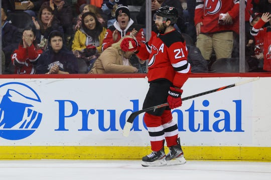 Feb 16, 2020; Newark, New Jersey, USA; New Jersey Devils right wing Kyle Palmieri (21) celebrates his goal during the second period against the Columbus Blue Jackets at Prudential Center. Mandatory Credit: Ed Mulholland-USA TODAY Sports