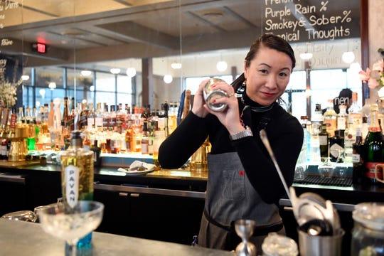 Owner Evelyn Ciszak makes a cocktail called La Vie en Rose at Brasserie Memere in Closter on Thursday, Feb. 13, 2020.