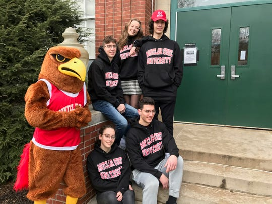 The Povolo quintuplets pose with Montclair State University's mascot, Rocky outside of the Passaic Valley High School.