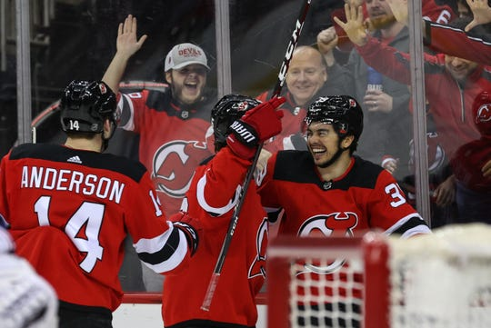 Feb 16, 2020; Newark, New Jersey, USA; New Jersey Devils right wing Nicholas Merkley (39) celebrates his goal during the second period against the Columbus Blue Jackets at Prudential Center. Mandatory Credit: Ed Mulholland-USA TODAY Sports