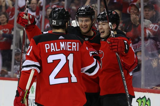 Feb 16, 2020; Newark, New Jersey, USA; New Jersey Devils right wing Joey Anderson (14) celebrates his goal during the second period against the New Jersey Devils at Prudential Center. Mandatory Credit: Ed Mulholland-USA TODAY Sports