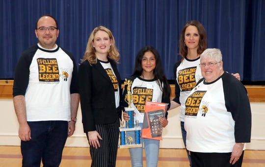 Pictured from left are event organizer David Valenzuela, pronouncer Rachel Bailey, spelling bee champion Karen Lozano, event organizer Cynthia Ochoa and judge Harriet Juricich.