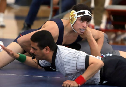 Wildcat senior Jesse Daniel Perez gets the pin en route to the 160-pound championship and his fourth straight district weight class title.