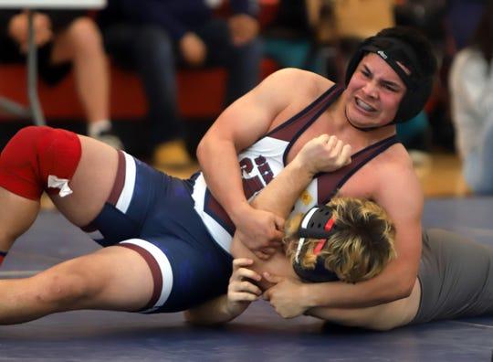 Senior Wildcat Fernie Munoz captured the district's 182-pound weight class championship.