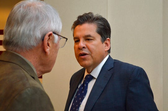 New Mexico Sen. Joseph Cervantes, D-Las Cruces, talks to a staffer on Monday, Feb. 17, 2020, at the Capitol in Santa Fe, N.M.