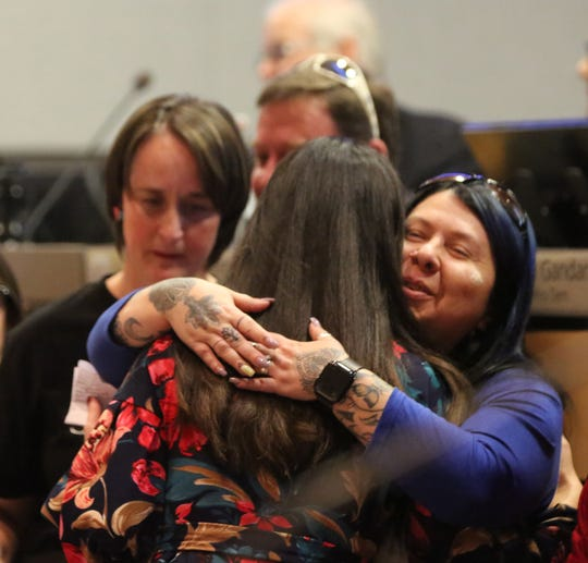 City Councilor Tessa Abeyta-Stuve hugs Las Cruces resident Trine Lane at the City Council meeting on Feb. 3, 2020, after presenting a mayoral proclamation for Congenital Heart Disease Awareness month. Lane's nephew, Brannden Fernandez, 16, who was born with dilated cardiomyopathy, a condition that causes a person's heart to enlarge, recently had a heart transplant at Stanford Children's Hospital in California. During the proclamation, Abeyta-Stuve said that she, too, was born with a heart defect.