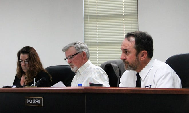 The Otero County Commission at their regular meeting Feb. 13.  From left: Otero County Vice-Chairwoman Lori Bies, Otero County Chairman Gerald Matherly and Otero County Commissioner Couy Griffin.
