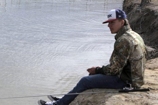 Cameron Swarts waits for a fish to bite, Monday, Feb. 17, 2020, at Lake Farmington.