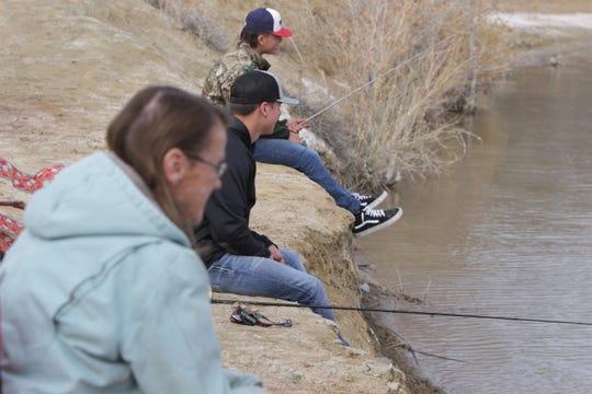 Cameron Swarts, Matt Swarts and Linda Swarts fish, Monday, Feb. 17, 2020, at Lake Farmington.