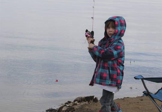 Piper Chivers, 4, fishes from shore, Monday, Feb. 17, 2020, at Lake Farmington.