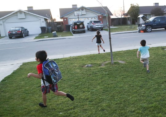 Children play at dusk in the small community of  McFarland, California, February 12, 2020.