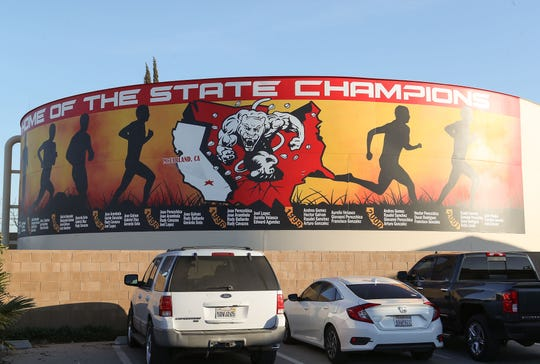 A mural celebrates the rich tradition of high school cross country champions in the small community of McFarland, California, February 12, 2020.