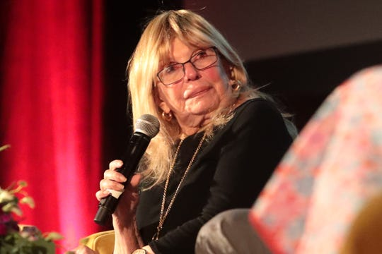 Nancy Sinatra speaks at a benefit produced by Modernism Week for the Plaza Theatre restoration on Sunday, Feb. 16, 2020 in Palm Springs, Calif.
