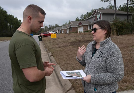 Whisper Creek HOA President Karen Rothwell talks earlier this month to fellow resident Alex Renfrow about a new school proposed for their neighborhood.