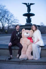 "Grayson Berry and Jessica Evans Berry pose with the bear she received on ""The Late Show with Stephen Colbert."""