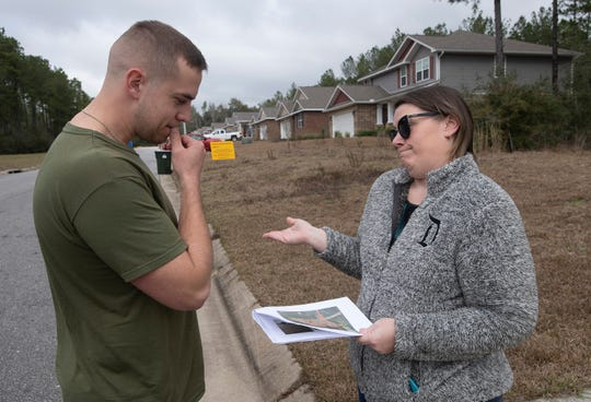 Karen Rothwell provides fellow Whisper Creek resident Alex Renfrow with an update on the proposed new school that the Santa Rosa School District wants to build on their street.