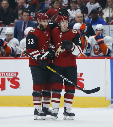 Coyotes' Clayton Keller (9) and Alex Goligoski (33) celebrate a goal during the first period against the Islanders  in Glendale, Ariz. on Feb. 17, 2020.