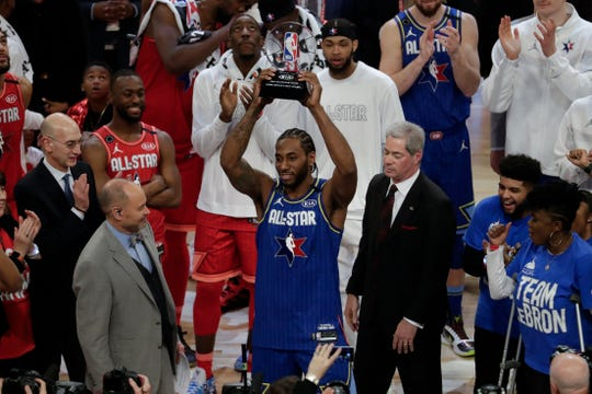 Kawhi Leonard of the Los Angeles Clippers holds up his NBA All-Star Game Kobe Bryant MVP Award after the NBA All-Star basketball game Sunday, Feb. 16, 2020, in Chicago. (AP Photo/David Banks)