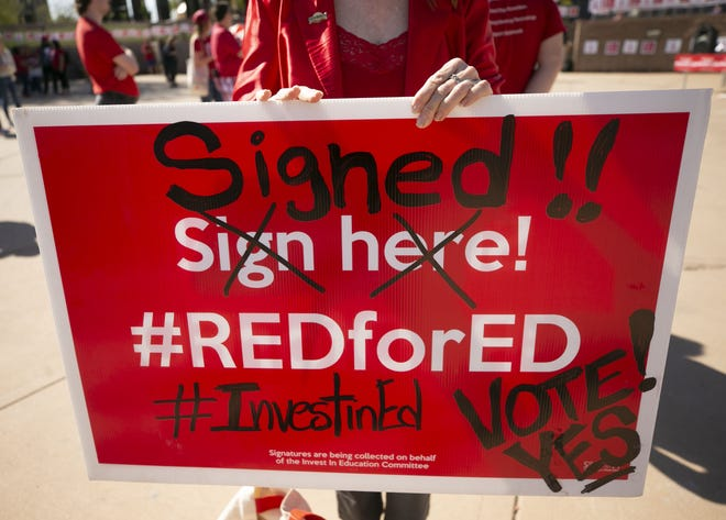 #RedForEd supporters rally at the Arizona State Capitol in Phoenix on Monday, Feb. 17, 2020, to begin collecting signatures for the Invest in Ed ballot initiative.