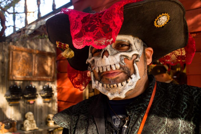 Victor Hernandez shows his mask during the 32nd annual Renaissance Festival Sunday, Feb. 16, 2020 in Gold Canyon.