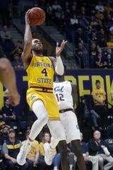 Arizona State forward Kimani Lawrence (4) shoots in front of California forward Kuany Kuany (12) during the first half of an NCAA college basketball game in Berkeley, Calif., Sunday, Feb. 16, 2020. (AP Photo/Jeff Chiu)