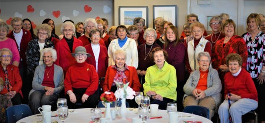 Around 100 widows attended the Valentine's Lunch. Here, ladies gather for a group photo.