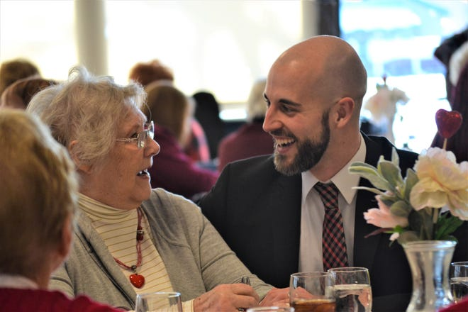 Pastor Ryan Morter enjoys a fun moment with one of the lunch attendees.