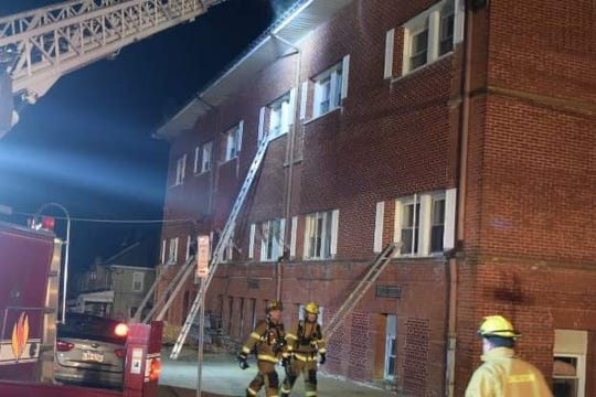 Firefighters responding to a fire at the Hilltop Apartments overnight Saturday into Sunday battled the blaze from the exterior, using numerous ladders, as well as the interior, sending teams inside.