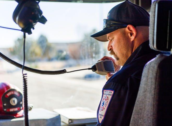 Josh Cohen, Fire Captain, radios dispatch following a medical aid call.