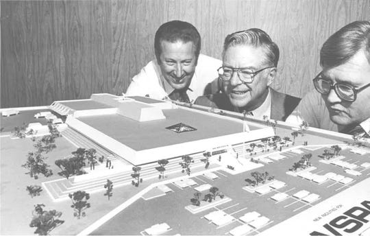 A model of the Reno Gazette Journal building at 955 Kuenzli Street. Pictured left to right: Gene Moni, production director for Gazette and Journal; Ray Hellman, architect who designed building; and Warren L. Lerude, publisher.