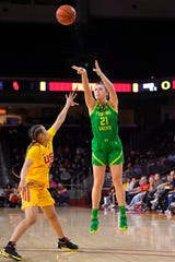Oregon forward Erin Boley, right, shoots as Southern California guard Endyia Rogers defends during the second half of an NCAA college basketball game Feb. 16, 2020, in Los Angeles.