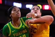 Oregon forward Ruthy Hebard, left, and Southern California forward Alissa Pili look for a rebound during the first half of an NCAA college basketball game  Feb. 16, 2020, in Los Angeles.