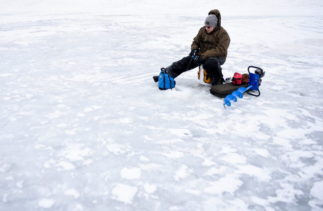 Matthew Krier waits on fish to bite on Monday, Feb. 17, 2020 at Terrace Park in Sioux Falls.