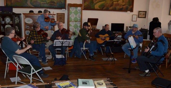 South Dakota Fiddlers and Irish band (left-to-right): Matt Tyler, fiddle; Bill Peterson, fiddle; Ken Duda, fiddle; Joel Brick, fiddle; Bryan Schultz, Banjo; Bill Renneker, guitar; Ken Nelson, mandolin; Glen Enright, accordion.