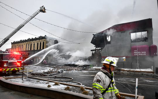 Firefighters are on the scene of a fire at the Press Bar Monday, Feb. 17, 2020, in downtown St. Cloud. The fire was called in at about 2:45 a.m. The building on the corner of Fifth Avenue and St. Germain Street was built in 1881.