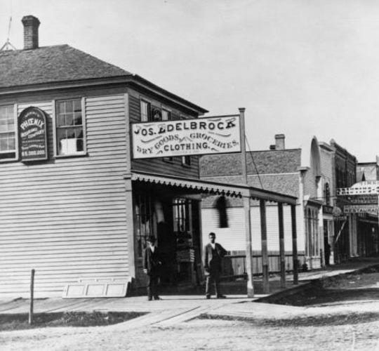 Joseph Edelbrock's general store circa 1877 was the city's first post office and sold dry goods, clothing and shoes. The original building was rebuilt in 1881. The Press Bar & Parlor opened at the site in 1947.