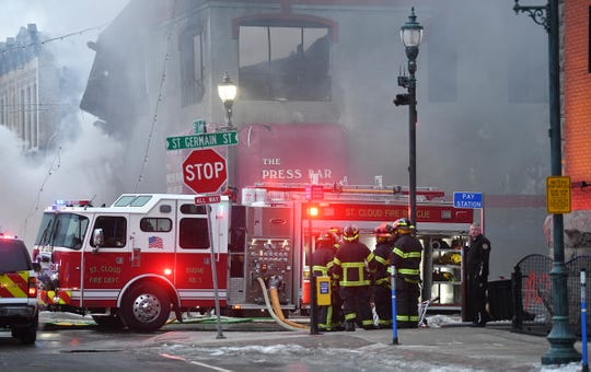 Frefighters gather at the scene of a fire at the Press Bar Monday, Feb. 17, 2020, in downtown St. Cloud.