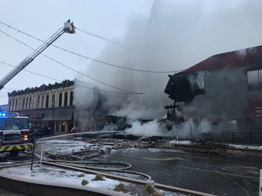 Crews battle a fire at the Press Bar in downtown St. Cloud Monday morning, February 17, 2020.
