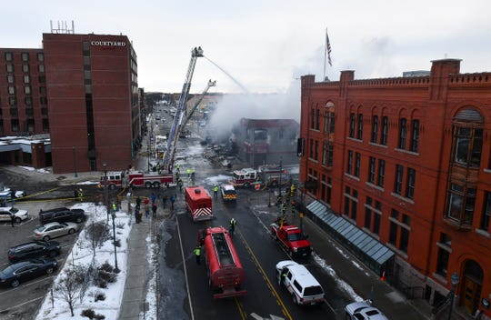Firefighters are on the scene of a fire at the Press Bar Monday, Feb. 17, 2020, in downtown St. Cloud.