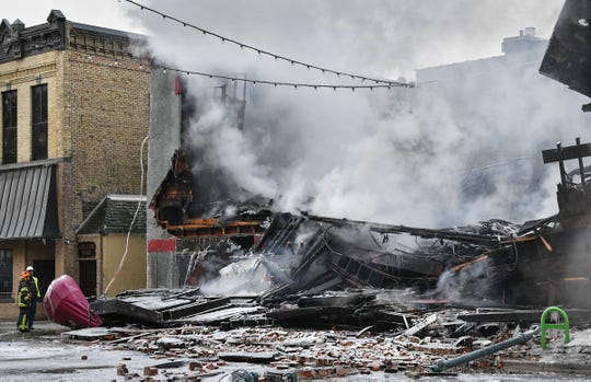 St. Cloud firefighters are on the scene of a fire at the Press Bar Monday, Feb. 17, 2020, in downtown St. Cloud.