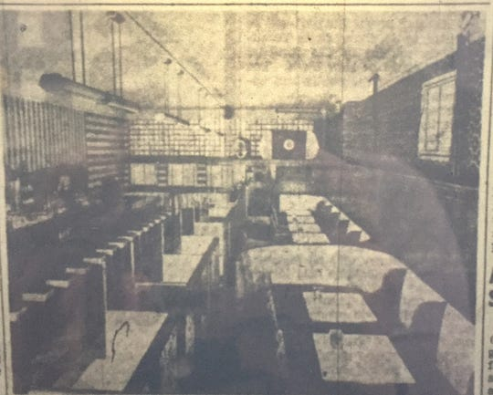 """A picture in the Dec. 7, 1949 edition of the St. Cloud Times shows the newly remodeled interior at the Press Bar. The cutline reads, """"A portion of the newly remodeled interior of the Press Bar and Cafe is shown here with the new seating arrangement of the establishment. Walnut paneling has been used extensively throughout and approximately 100 persons can now be seated. Booths along the wall are on a raised terrace."""""""