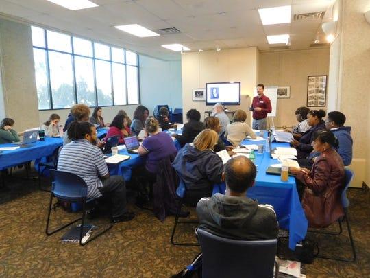 Dr. Josh Goodman shows secondary teachers a digitized historic photograph.