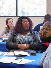 """Talia Cotton was one of more than 50 educators at seminar on black history:  """"I am an African American woman and my mother actually integrated schools. I'm one generation from that."""""""