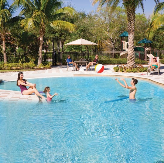 Residents enjoy the resort-style pool at Canopy Creek in Palm City prior to the COVID-19 outbreak.